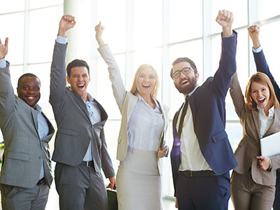 Five Happy Employees Jumping With Hands in the Air Because Their Company Switched to VoiceSpring Cloud Hosted Business Phone Systems