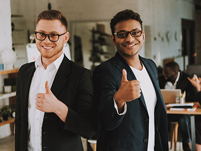 Two men in suits giving thumbs up for quality business phone service providers